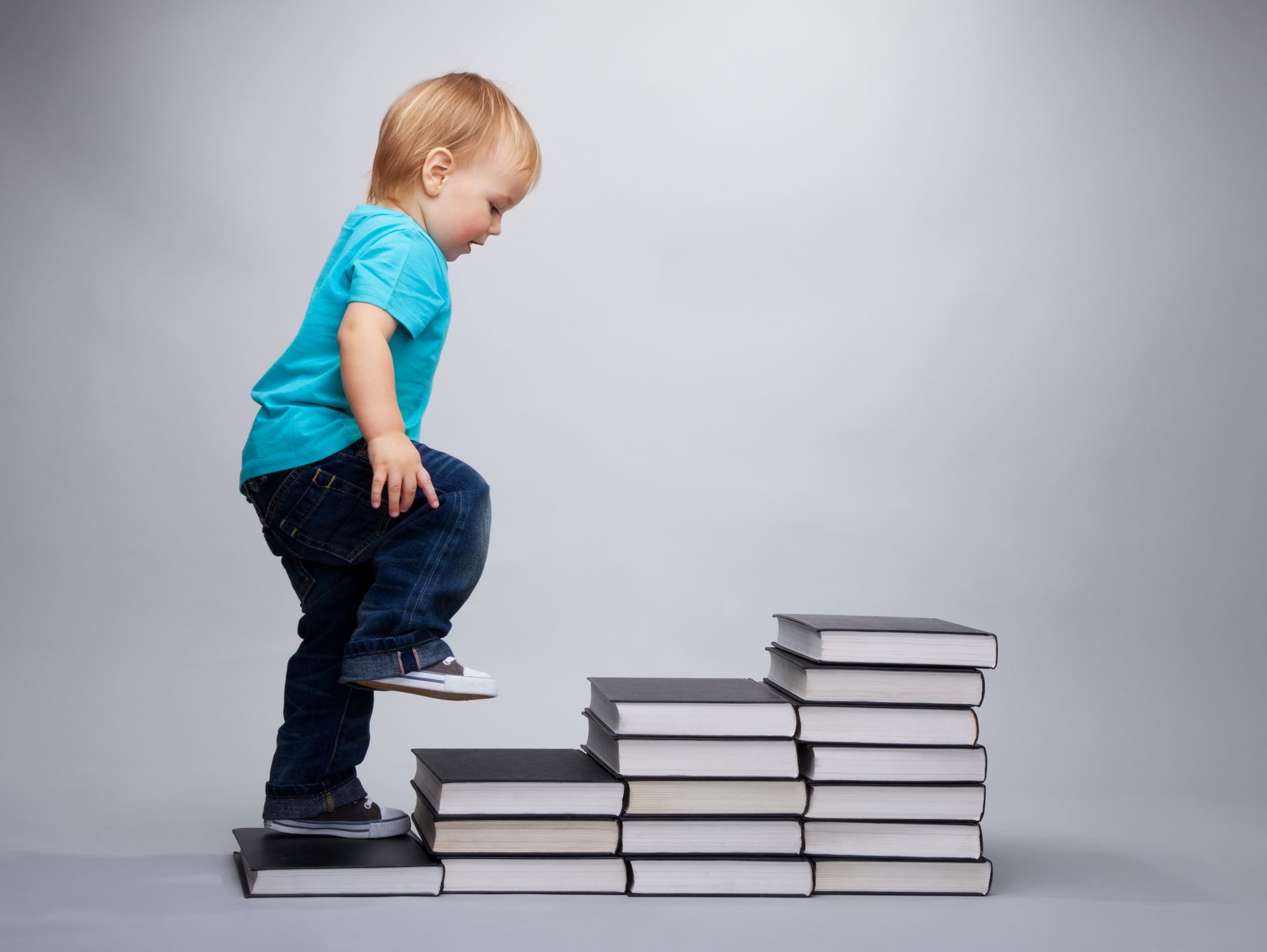 baby walking on books